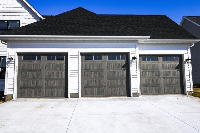 Faux Wood Paneled Garage doors installed in a New Home