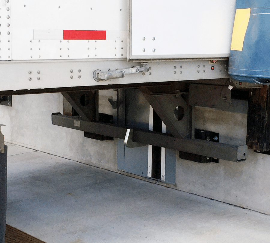 Active vehicle restraint for loading docks