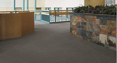 Building carpeted with strong durable carpet tile pin
