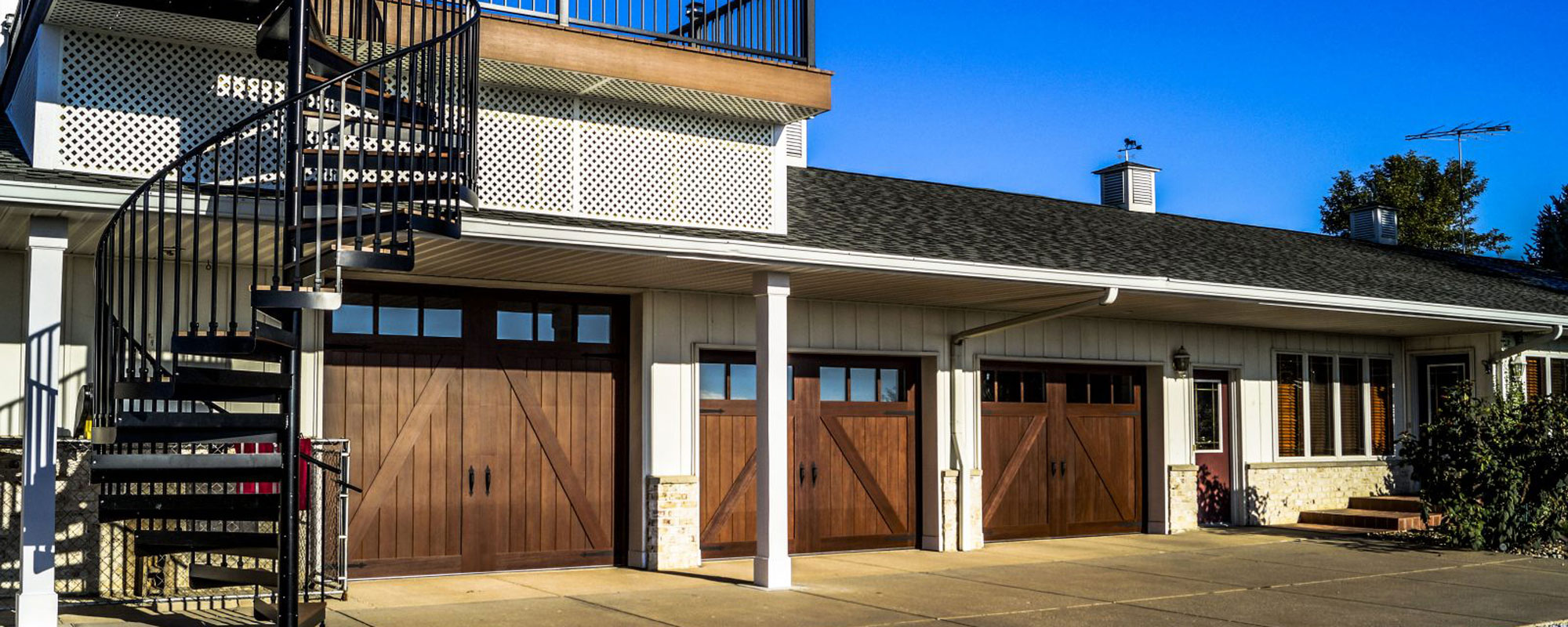 Ranch-style overhead doors installed in home
