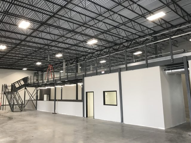 Emerge Academy Mezzanine installed in open warehouse space
