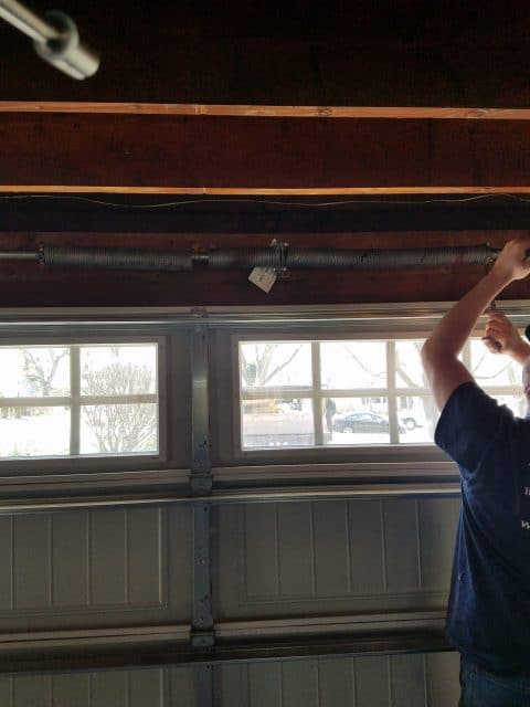 service tech working on garage door