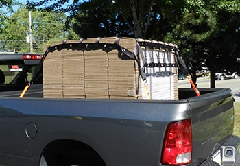 Truck Bed Cargo Net securing skid to truck bed