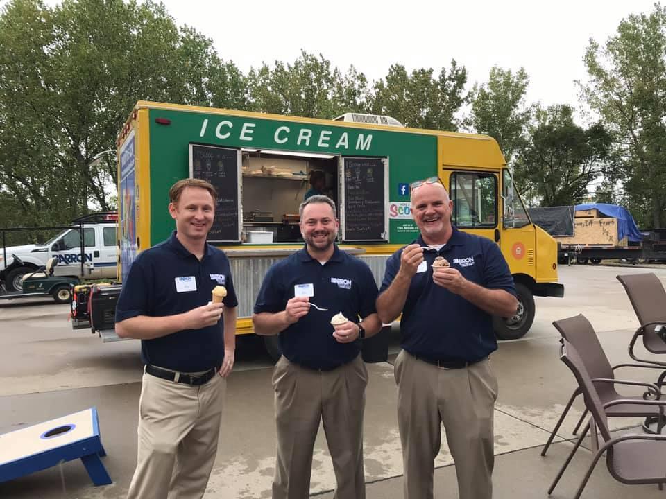 Employees eating ice cream